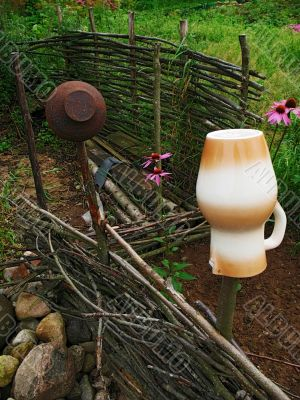 village life - braided fence and pitcher