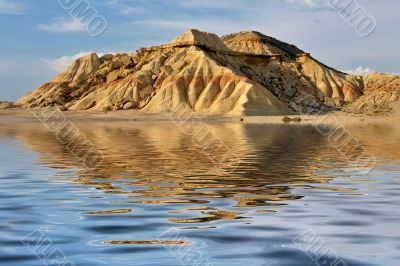 Hill reflected in the water