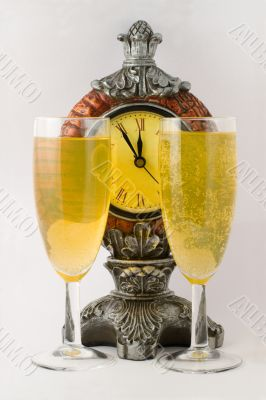 Clock and two tall wine glass