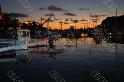 Color fish boat at night