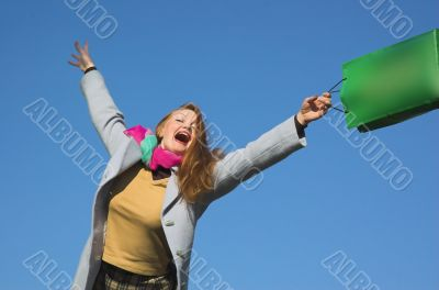 The woman with purchases on a background of the