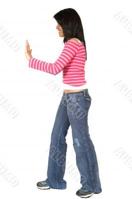 casual girl pushing something aside