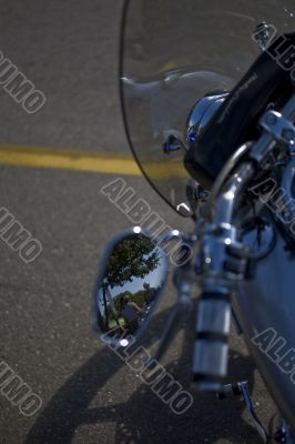 motorcycle with people in mirror