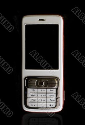 White cellular phone on black background