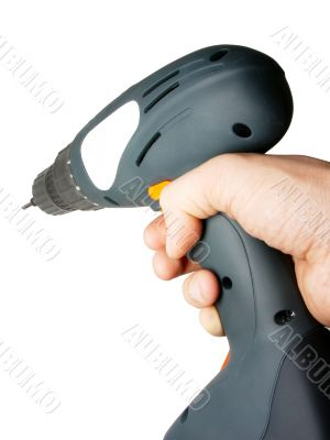 hand holding electric screwdriver