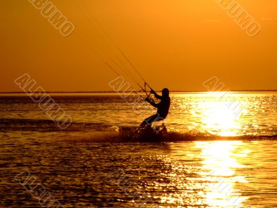 Silhouette of a kitesurf on a gulf on a sunset 2