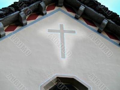 illuminated cross on church
