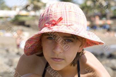 teenage girl in the hat on the beach