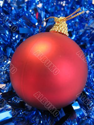 Red christmas balls and blue glare