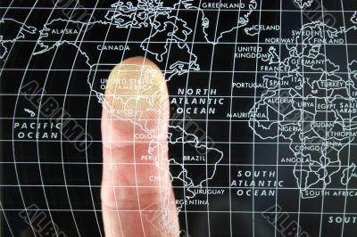 Finger on world Map
