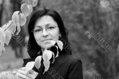 young woman with black hair in glasses, autumn shot