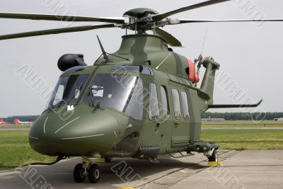 A dark green helicopter