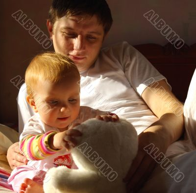 Father play with little daughter