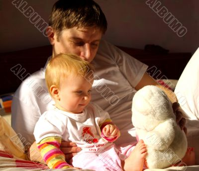 Father play with  daughter