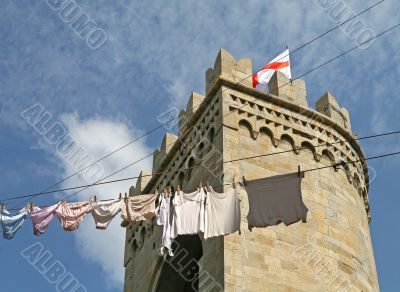 Genoa: clothesline in front of historic tower