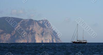 Sailing ship and rocks