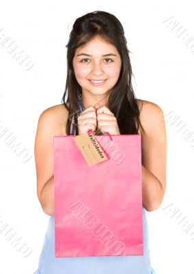 beautiful teenager with shopping bag