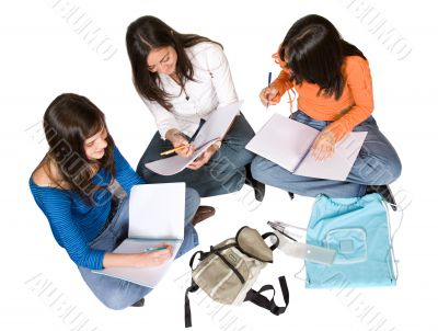 beautiful students studying on the floor