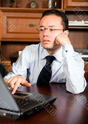 business man in his office on a laptop