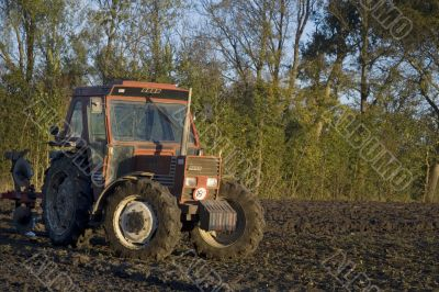 tractor in cultivated field
