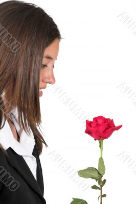 business girl admiring rose