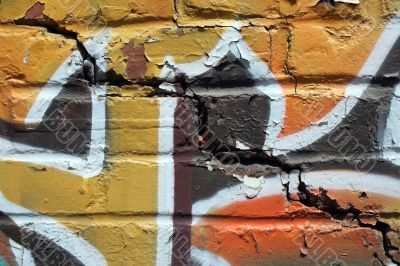 Bright graffiti on a cracked brick wall