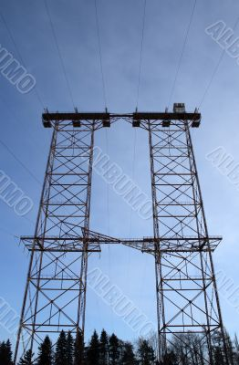 Big double electricity pylon in the forest