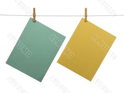Blank paper sheets on a clothes line (+clipping path)