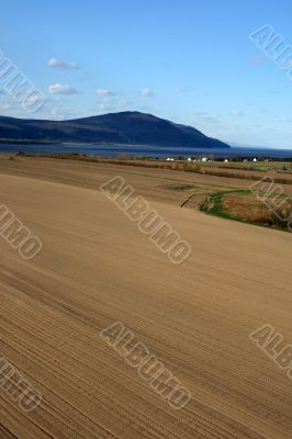 Spacious ploughed land ready for cultivation