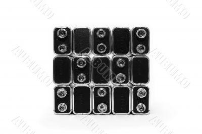 Nine volt batteries forming a square