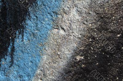 Graffiti detail on a grainy concrete wall