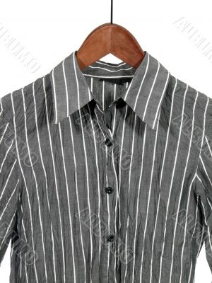 Gray striped shirt on wooden hanger