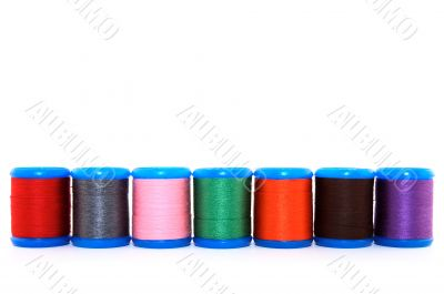Row of colorful thread spools