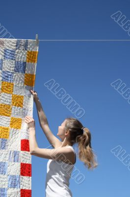 Young woman and bright laundry