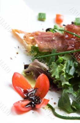 Season salad with crispy parma ham