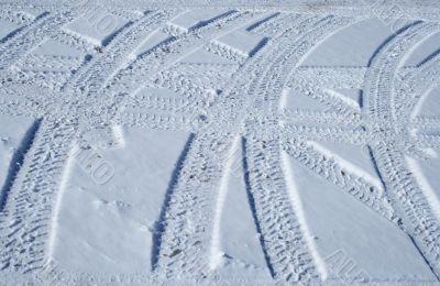 Tire tracks crossing the snowy terrain