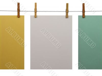 Colorful paper sheets on a clothes line (+clipping path)