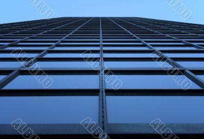 Glass-windowed skyscraper reaching the sky