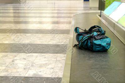 backpack on conveyor