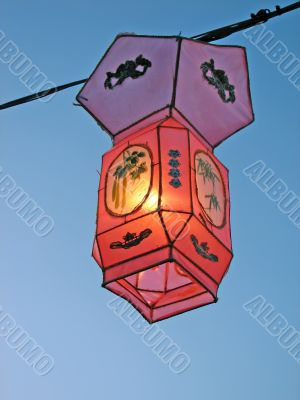 Cozy light of a pink Chinese lantern