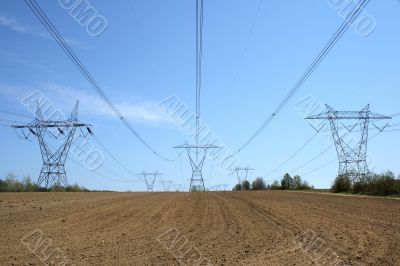 Electricity pylons in cultivated land
