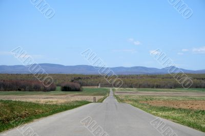 Country road leading to mountains