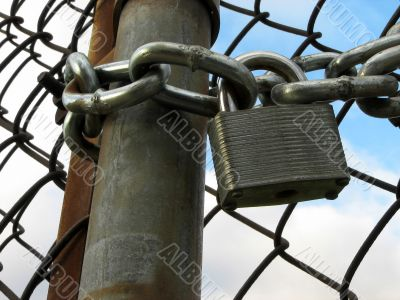Lock, chains and chain link fence