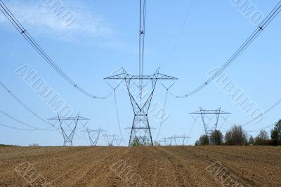 Electricity pylons in farmland
