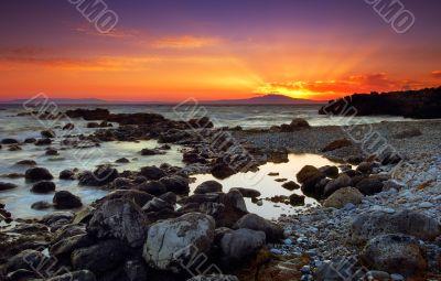 Glorious sunset over rocky seascape