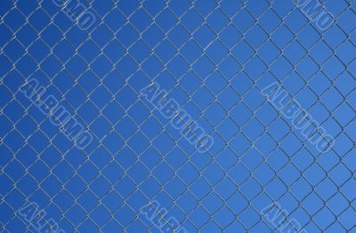 Chain link fence against the blue sky