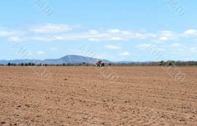 Tractor plowing land in spring