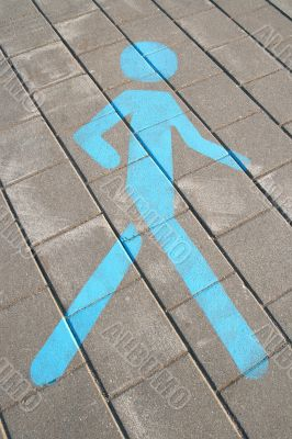 Pedestrian sign on the pavement