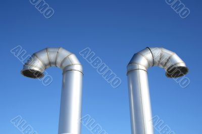 Two shiny metal ventilation pipes