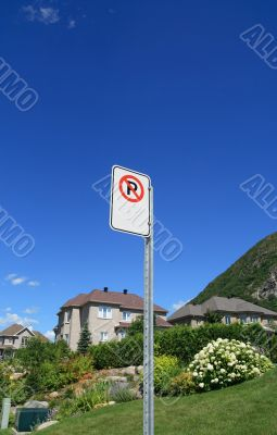 No parking sign in a rich suburban neighborhood